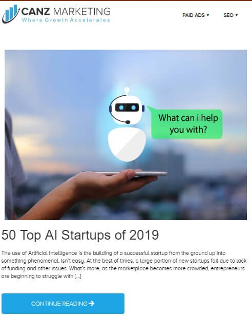 A screenshot of a blog from Canz Marketing blog section titled *50 Top AI Startups of 2019* with a hand holding a cellphone. A robotic figure is shown over the cell phone, appearing to ask *What can I help you with?*