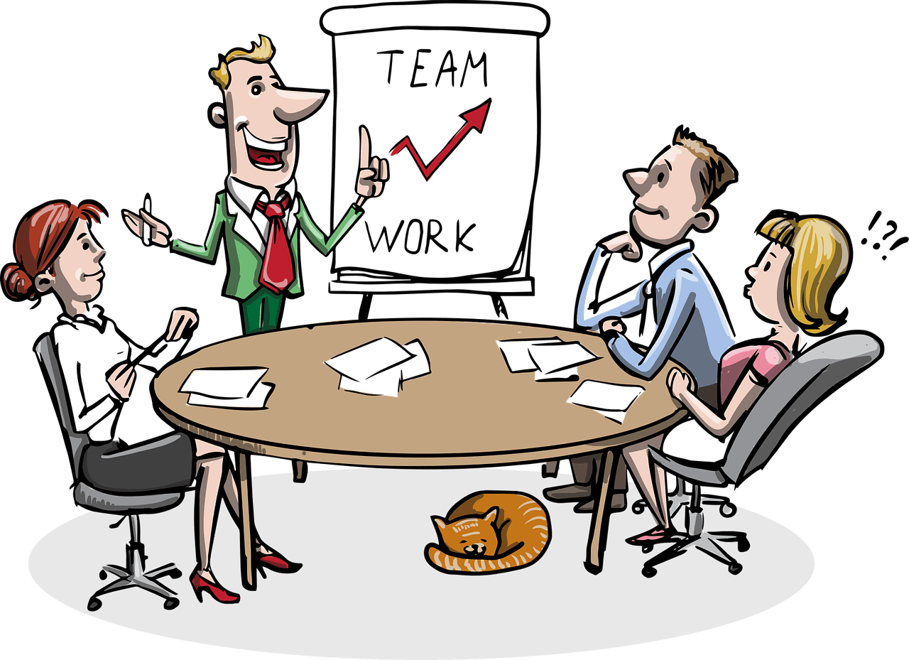 An illustration of a team sitting around a round table listening to a presenter. A few pages lie in front of each member. A board saying *growth with teamwork* is placed next to the presenter. A cat is resting right under the meeting table.