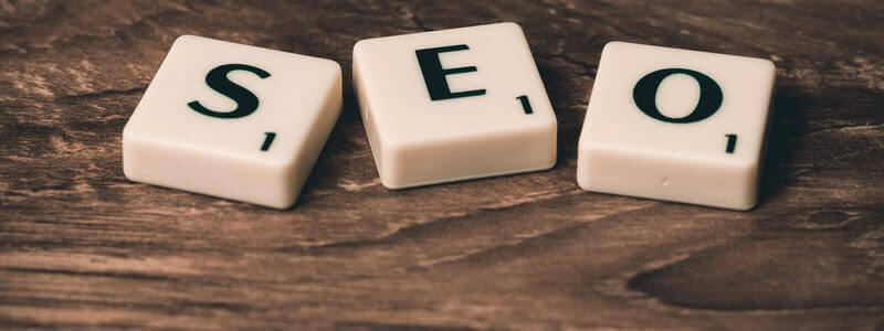 Three scrabble squares placed in line, making the word SEO.